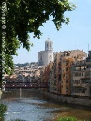 A View Of The Historic Quarter Of Girona From Across The River Onyar