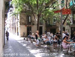 The Climate In Gerona Is Pleasant All Year Round. Here People Are Sitting Out At The Terrace Cafes In July